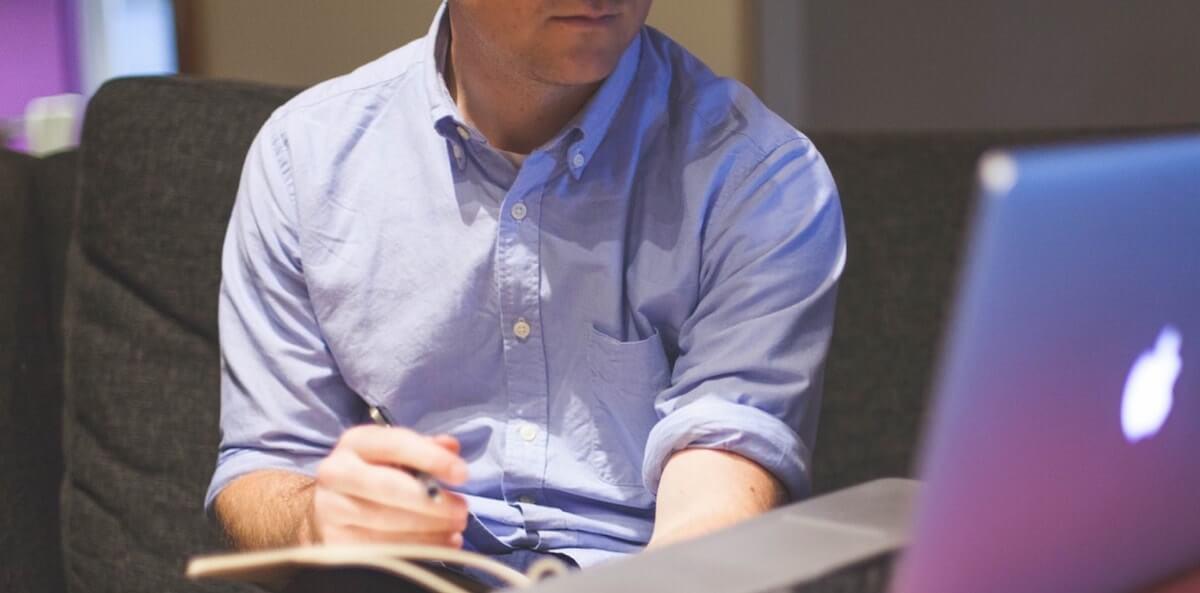 Man looking at computer macbook